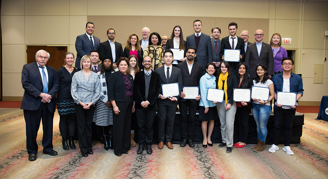Members of the Chicago Consular Corps pose with UIC student scholarship winners.