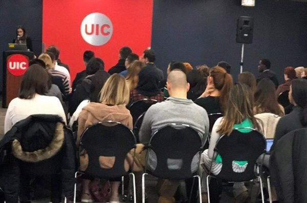 UIC students listen to a presentation given by the Consul General of Argentina.
