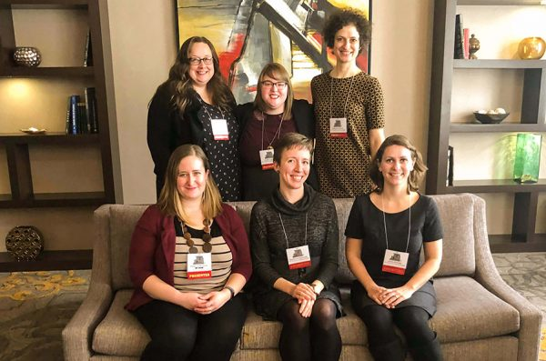Six Tutorium in Intensive English instructors pose for a photograph at the Illinois Teachers of English to Speakers of Other Languages – Bilingual Education 44th annual convention, Feb. 22-23, in Lisle.