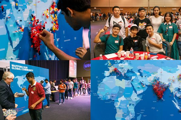 Four images from the event including a student pressing a pin into the map, students posing with smiles, and a student meeting the Chancellor