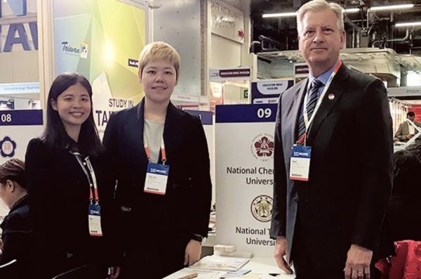 Dr. Neal McCrillis with delegates Kitty Chen and Tzu-yu Huang